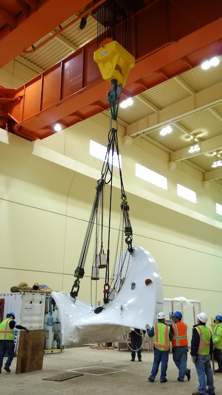 The new, high-tech replacement turbine for Ice Harbor's hydroelectric generator Unit-2 was delivered in segments by truck and assembled inside the powerhouse.