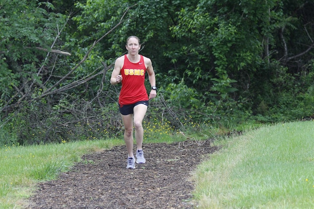 Capt. Christine Taranto, logistics analyst with Marine Corps Systems Command's Acquisition Logistics and Product Support, trains on trails at Marine Corps Base Quantico, Virginia. Taranto, an active triathlete and marathoner, was recognized on May 11 as the Marine Corps 2015 Female Athlete of the Year. (U.S. Marine Corps photo by Mathuel Browne)