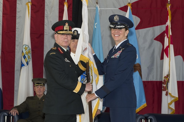 U.S. Air Force Gen. Lori J. Robinson receives the North American Aerospace Defense Command guidon from the Canadian Chief of Defence Staff, Gen. J.H. Vance signifying her acceptance of command, May 13, 2016 on Peterson Air Force Base, Colo. Gen. Robinson is the 24th NORAD commander.