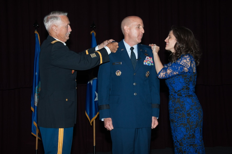 Brig. Gen. Edward W. Thomas Jr. is pinned by his father, Retired Army Maj. Edward W. Thomas, Sr. and Gen. Thomas' wife, Dinah during his promotion ceremony at the Non Commissioned Officer Academy, Maxwell Air Force Base, May 12, 2016.  Thomas is only one of two career Public Affairs flag officers. (US Air Force photo by Melanie Rodgers Cox)