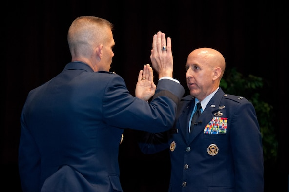 Lt. Gen. Steven Kwast, commander Air University administers the oath of office to Brig. Gen. Edward Thomas in the Non Commissioned Officer Academy at Maxwell Air Force Base, May 12, 2016.  Thomas is the commander of the Thomas N. Barnes Center for Enlisted Education. (US Air Force photo by Melanie Rodgers Cox)