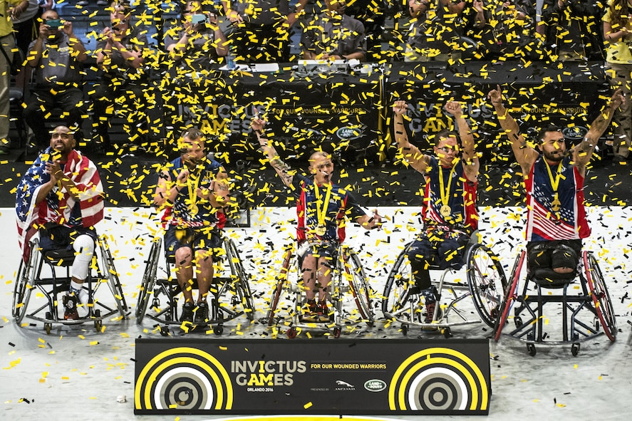 U.S. wheelchair basketball team members celebrate their gold medal win during the 2016 Invictus Games.