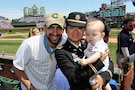 From left to right: Retired U.S. Army Capt. Florent 'Flo' Groberg, Medal of Honor recipient, U.S. Army Reserve 1st Lt. Jiaru Bryar, 85th Support Command, with her 10-month-old, Mason, pause for a photo together during the Chicago Cubs vs Washington Nationals Mothers Day game at Wrigley Field, May 8, 2016. Bryar and Groberg were both honored during the game in front of more than 37,500 in attendance.