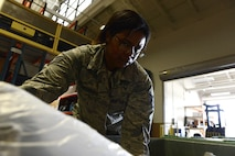 U.S. Air Force Staff Sgt. Marquita Campbell, 20th Logistics Readiness Squadron individual protective equipment supervisor, stores tactical vests at Shaw Air Force Base, S.C., May 11, 2016. The IPE shop is the first line of defense for Airmen, ensuring protective gear is supplied and functions properly. (U.S. Air Force photo by Airman 1st Class Destinee Dougherty)