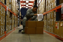 U.S. Air Force Airman 1st Class Emanuel Castro, 20th Logistics Readiness Squadron individual protective equipment apprentice, logs and stores gas masks at Shaw Air Force Base, S.C., May 11, 2016. The IPE shop issues approximately 30 gas masks each week for deployments as well as training exercises such as chemical, biological, radiological, and nuclear training and combat arms training. (U.S. Air Force photo by Airman 1st Class Destinee Dougherty)