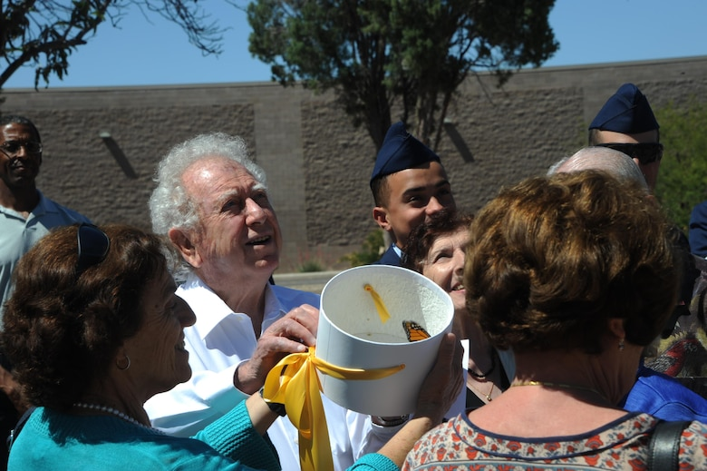 Pawel Lichter and additional Holocaust survivors release butterflies during the Holocaust Day of Remembrance at Davis-Monthan Air Force Base, Ariz., May 9, 2016. The ceremony concluded outside with the release of butterflies as a symbol of hope. (U.S. Air Force photo by Airman Nathan H. Barbour)