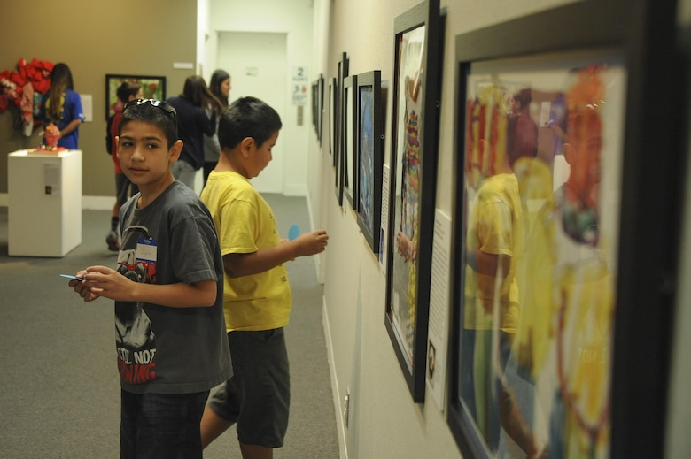 Joshua and Jacob Cardenas observe an art exhibit during Month of the Military Child Family Art Series: Creative Explorations for Hope at the University of Arizona Museum of Art in Tucson, Ariz., April 30, 2016. The art was created by artists from ArtWorks, a program under the university and community art space for adults with intellectual and developmental disabilities. (U.S. Air Force photo by Airman 1st Class Mya M. Crosby/Released)
