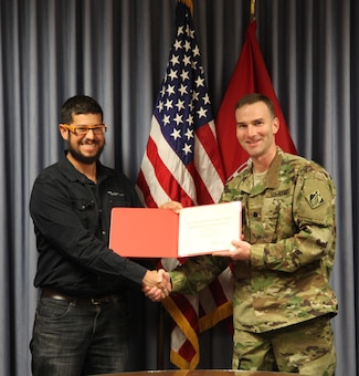 ALBUQUERQUE, N.M. – District Commander Lt. Col. Patrick Dagon presents civil engineer Carlos Aragon a certificate of achievement for being selected as one of two District Employees of the Second Quarter, May 2, 2016.