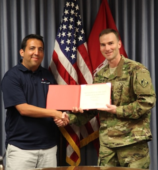 ALBUQUERQUE, N.M. – District Commander Lt. Col. Patrick Dagon presents economist Robert Grimes a certificate of achievement for being selected as one of two District Employees of the Second Quarter, May 2, 2016.