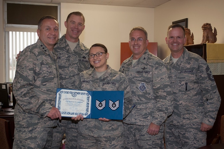 Staff Sgt. Katheryn Campbell, 30th Medical Support Squadron medical readiness flight chief, poses with Lt. Gen. David J. Buck, Commander, 14th Air Force (Air Forces Strategic), Air Force Space Command; and Commander, Joint Functional Component Command for Space, U.S. Strategic Command, Chief MSgt. Craig Neri, Command Chief Master Sergeant, 14th Air Force (Air Forces Strategic), Air Force Space Command; and Command Senior Enlisted Leader, Joint Functional Component Command for Space, U.S. Strategic Command, Col. J. Christopher Moss, Commander 30th Space Wing, and Chief MSgt. Robert Bedell, 30th Space Wing command chief, after recently being selected for STEP promotion to technical sergeant, Vandenberg Air Force Base, Calif. Campbell is soon leaving Vandenberg to take the next step in her career - becoming a bioenvironmental technical school instructor at Wright-Patterson Air Force Base.