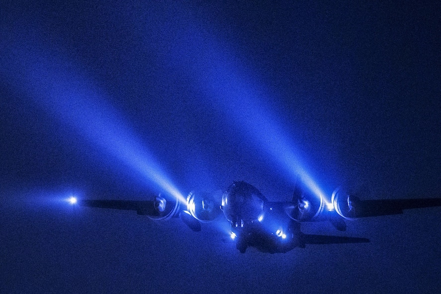 A C-130 Hercules conducting a night flight mission.
