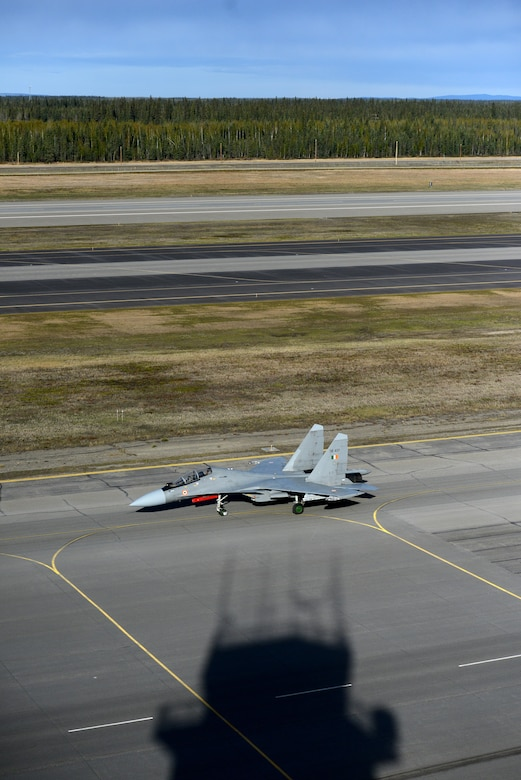 A Sukhoi SU-30 MKI taxi's down the tarmac. The SU-30 is a twinjet multirole air superiority fighter developed by Russia's Sukhoi and built under licence by India's Hindustan Aeronautics Limited for the Indian Air Force. (U.S. Air Force photo by Tech. Sgt. Steven R. Doty)