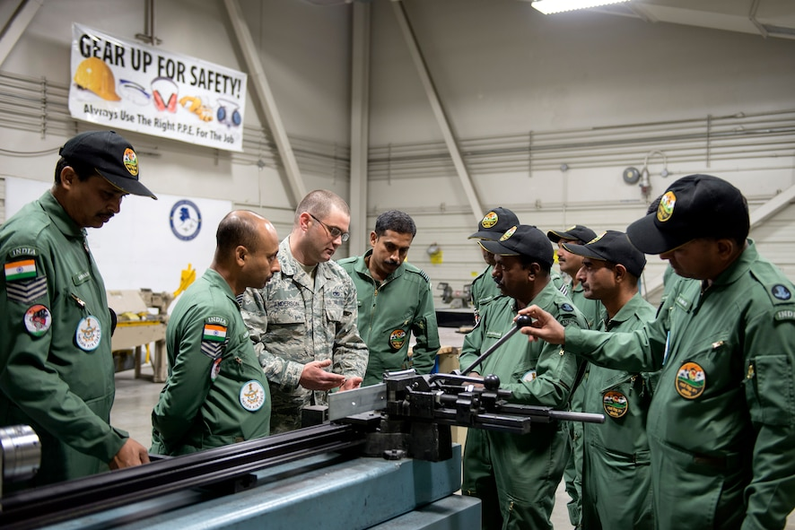U.S. Air Force Technical Sergeant James Anderson, 354th Maintenance Squadron, provides insight into sheet metal operations to Airman with the Indian Air Force, here, May 10, 2016. (U.S. Air Force photo by Staff Sgt. Ashley Taylor)
