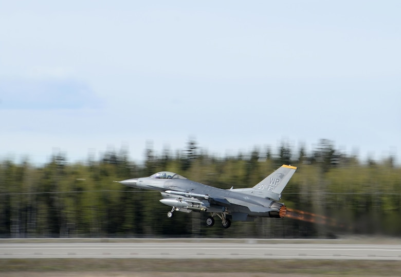 A U.S. Air Force F-16 Fighting Falcon assigned to the 80th Fighter Squadron out of Kunsan Air Base, Republic of Korea, takes off from Eielson Air Force Base, Alaska, May 4, 2016, during RED FLAG-Alaska (RF-A) 16-1. RF-A is a series of Pacific Air Forces commander-directed field training exercises for U.S. and partner nation forces, enabling joint and international units to sharpen their combat skills by flying simulated combat sorties in a realistic threat environment inside the Joint Pacific Alaska Range Complex, the largest instrumented air, ground and electronic combat training range in the world. (U.S. Air Force photo by Master Sgt. Karen J. Tomasik/Released)