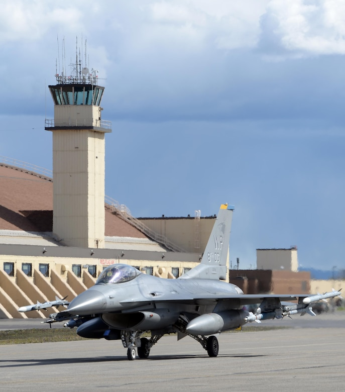 A U.S. Air Force F-16 Fighting Falcon pilot assigned to the 80th Fighter Squadron out of Kunsan Air Base, Republic of Korea, taxis down the Eielson Air Force Base, Alaska, flight line in a jet painted with the 8th Operations Group markings, May 4, 2016, in preparation for a RED FLAG-Alaska (RF-A) 16-1 afternoon mission. Wolf Pack pilots can sharpen their combat skills in the Joint Pacific Alaska Range Complex, which provides more than 67,000 square miles of airspace, one conventional bombing range and two tactical bombing ranges containing 510 different types of targets and 45 threat simulators, both manned and unmanned. (U.S. Air Force photo by Master Sgt. Karen J. Tomasik/Released)