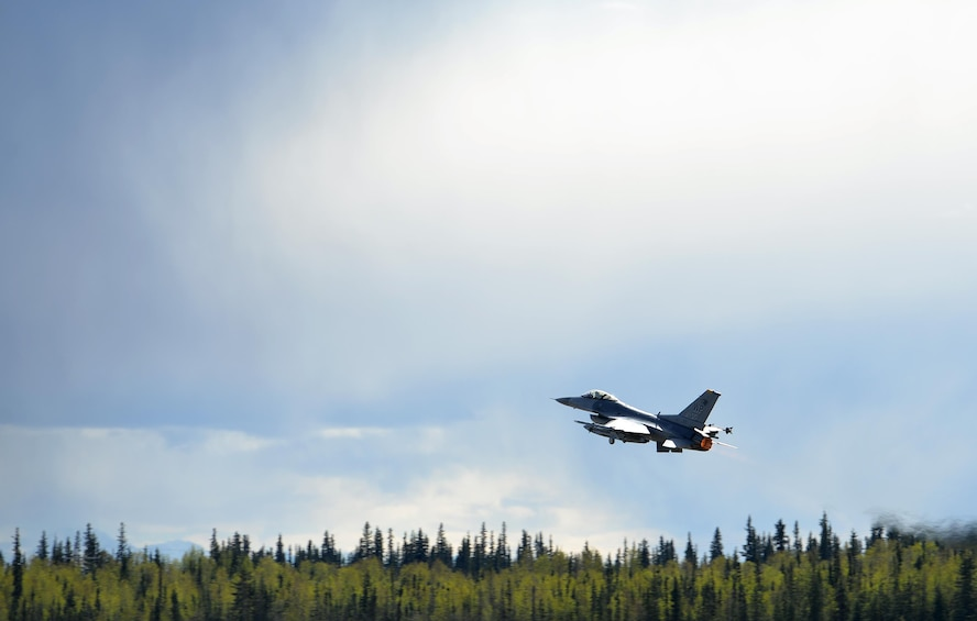 A U.S. Air Force F-16 Fighting Falcon assigned to the 80th Fighter Squadron out of Kunsan Air Base, Republic of Korea, takes off from Eielson Air Force Base, Alaska, under semi-cludy skies May 4, 2016, during RED FLAG-Alaska (RF-A) 16-1. RF-A is a series of Pacific Air Forces commander-directed field training exercises for U.S. and partner nation forces, enabling joint and international units to exchange tactics, techniques and procedures while improving interoperability in a realistic threat environment inside 67,000 square miles of expansive co-located air and land ranges known as the Joint Pacific Alaska Range Complex. (U.S. Air Force photo by Master Sgt. Karen J. Tomasik/Released)