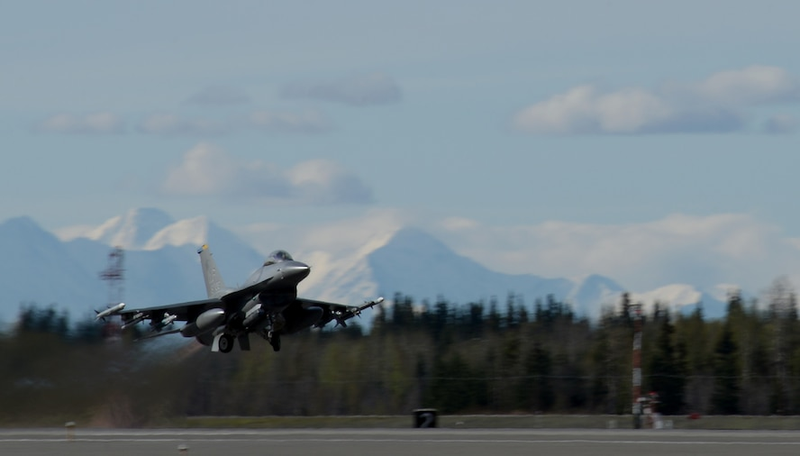 A U.S. Air Force F-16 Fighting Falcon assigned to the 80th Fighter Squadron out of Kunsan Air Base, Republic of Korea, takes off from Eielson Air Force Base, Alaska, May 2, 2016, during RED FLAG-Alaska (RF-A) 16-1. RF-A is a series of Pacific Air Forces commander-directed field training exercises for U.S. and partner nation forces, enabling joint and international units to sharpen their combat skills by flying simulated combat sorties in a realistic threat environment inside the Joint Pacific Alaska Range Complex, the largest instrumented air, ground and electronic combat training range in the world. (U.S. Air Force photo by Master Sgt. Karen J. Tomasik/Released)