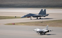 A U.S. Air Force F-16 Fighting Falcon assigned to the 80th Fighter Squadron out of Kunsan Air Base, Republic of Korea, waits on the Eielson Air Force Base, Alaska, flight line May 6, 2016, as an Indian air force Su-30 MKI aircraft taxis by after a RED FLAG-Alaska (RF-A) 16-1 mission. RF-A is a series of Pacific Air Forces commander-directed field training exercises for U.S. and partner nation forces, enabling joint and international units to sharpen their combat skills by flying simulated combat sorties in a realistic threat environment inside the Joint Pacific Alaska Range Complex, the largest instrumented air, ground and electronic combat training range in the world. (U.S. Air Force photo by Master Sgt. Karen J. Tomasik/Released)