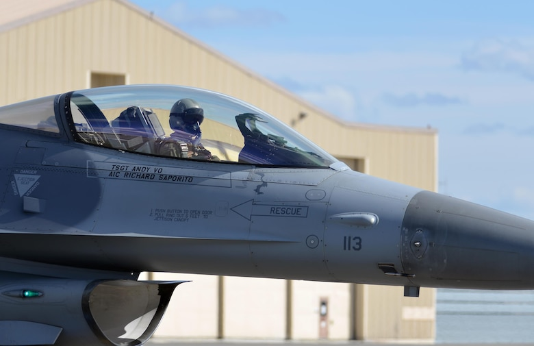 A U.S. Air Force F-16 Fighting Falcon pilot assigned to the 80th Fighter Squadron out of Kunsan Air Base, Republic of Korea, taxis down the Eielson Air Force Base, Alaska, flight line May 5, 2016, in preparation for a RED FLAG-Alaska (RF-A) 16-1 afternoon mission. RF-A is a series of Pacific Air Forces commander-directed field training exercises for U.S. and partner nation forces, enabling joint and international units to exchange tactics, techniques and procedures while improving interoperability in a realistic threat environment inside 67,000 square miles of expansive co-located air and land ranges known as the Joint Pacific Alaska Range Complex. (U.S. Air Force photo by Master Sgt. Karen J. Tomasik/Released)