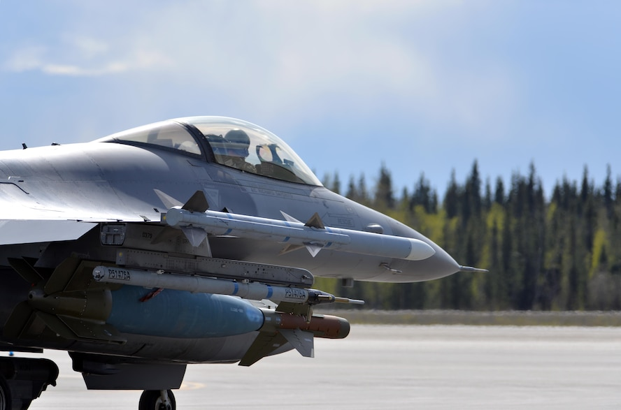 A U.S. Air Force F-16 Fighting Falcon pilot assigned to the 80th Fighter Squadron out of Kunsan Air Base, Republic of Korea, taxis down the Eielson Air Force Base, Alaska, flight line May 5, 2016, in preparation for a RED FLAG-Alaska (RF-A) 16-1 afternoon mission. Wolf Pack pilots can sharpen their combat skills in the Joint Pacific Alaska Range Complex, which provides more than 67,000 square miles of airspace, one conventional bombing range and two tactical bombing ranges containing 510 different types of targets and 45 threat simulators, both manned and unmanned. (U.S. Air Force photo by Master Sgt. Karen J. Tomasik/Released)