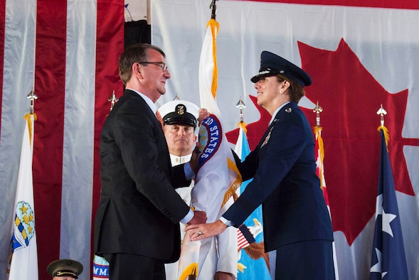 Defense Secretary Ash Carter hands the U.S. Northern Command flag to Air Force Gen. Lori J. Robinson during a change-of-command ceremony at Peterson Air Force Base, Colo., May 13, 2016. Carter presided as Robinson took command of North American Aerospace Defense Command and Northcom from Navy Adm. Bill Gortney. DoD photo by Air Force Senior Master Sgt. Adrian Cadiz