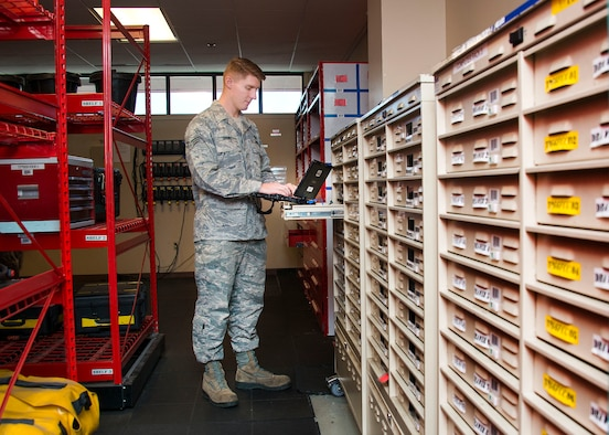 Senior Airman Richard Brown, 660th Aircraft Maintenance Squadron aerospace maintenance journeyman, checks out one of the many technical-order laptops used to perform maintenance and troubleshoot problems with the KC-10 aircraft at Travis Air Force Base, Calif. (U.S. Air Force photo by T.C. Perkins)