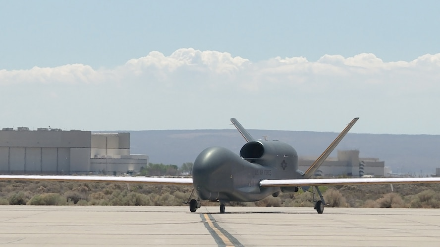 A Global Hawk remotely piloted vehicle taxis on the Edwards Air Force Base flightline during an icing test mission. The aircraft was fitted with a 3-D printed nylon structure to duplicate the weight and drag of ice forming on wings and tail. (U.S. Air Force photo by Chris Higgins.)