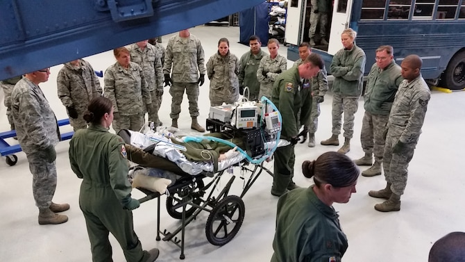 Students from the United States Air Force School of Aerospace Medicine Flight Nurse and Aeromedical Evacuation Technician Course, Class 2016D practice moving a patient from the C-17 trainer April 7. (U.S. Air Force photo/Bryan Ripple)