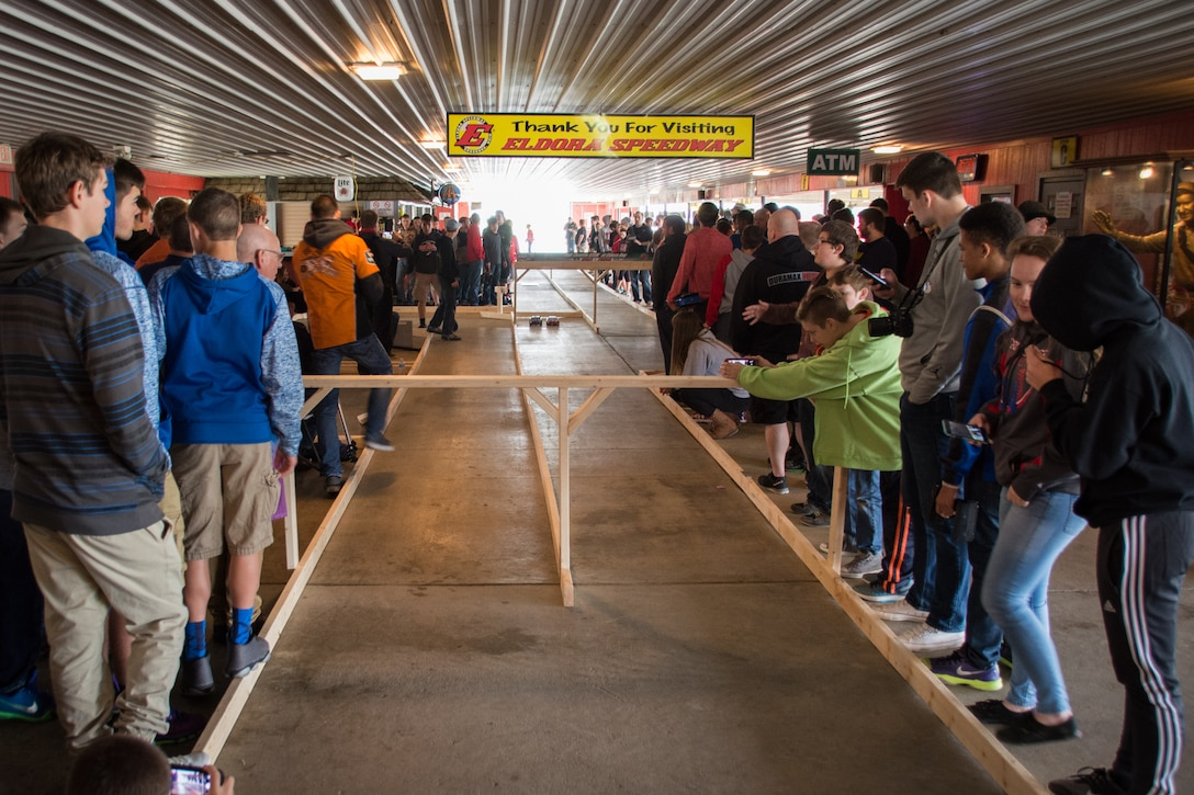 Students stand around the racetrack waiting for the remote controlled car races to begin during the Full Throttle STEM® at Eldora Day May 10. (U.S. Air Force photo/Richard Eldridge)
