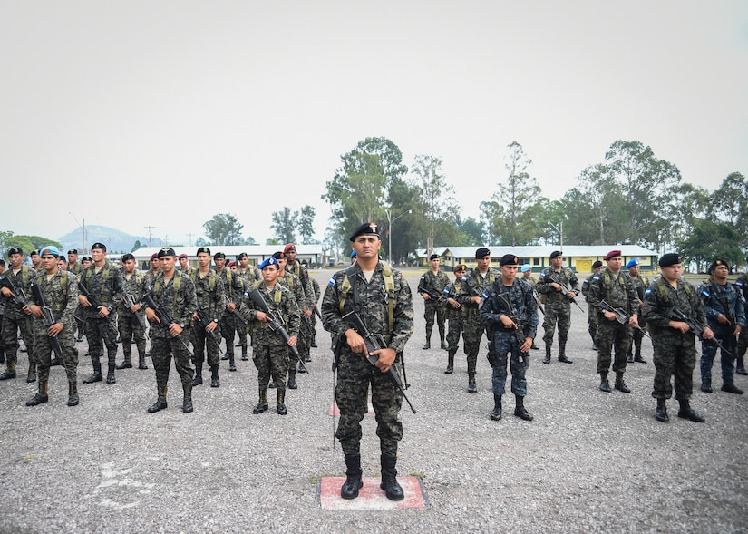 Members of the Honduran Army and TIGRES (Tropa de Inteligencia y Grupos de Respuesta Especial de Seguridad de la Policía Nacional) Special Police stand in formation during a Task Force-Caiman-sponsored Regionally Aligned Forces-Central America training closing ceremony in Tamara, Honduras, April 30, 2016. Throughout the three-week course, members of the 53rd Infantry Brigade Combat Team of the Florida Army National Guard trained the Hondurans on marksmanship, patrolling, battle drills, urban operations and other tasks designed to enhance their ability to counter transnational organized crime. (U.S. Air Force photo by Staff Sgt. Siuta B. Ika)