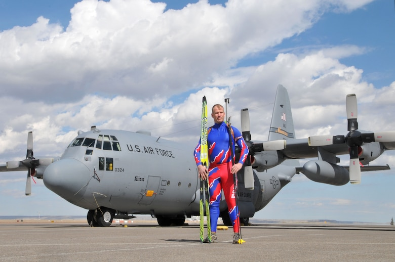 Staff Sgt. Ersnt Visscher, 120th Airlift Wing crew chief, poses in front of a C-130 Hercules for a photo with his biathlon skis, poles and rifle April 3, 2014. Visscher is the longest serving member of the Montana National Guard Biathlon team and only member who serves as a member of the Montana Air National Guard. (U.S. Air National Guard photo/Staff Sgt. Lindsey Soulsby)