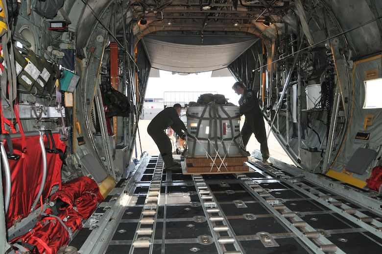 Loadmasters from the 186th Airlift Squadron secure a training cargo load aboard a Montana Air National Guard C-130 cargo aircraft. The cargo was intended to be dropped at the Chargin' Charlie Drop Zone at Malmstrom Air Force Base, Mont. March 5, 2016. Each load weighs nearly 1,000 pounds and was dropped from 1500 feet. (U.S. Air National Guard photo/Tech. Sgt. Michael