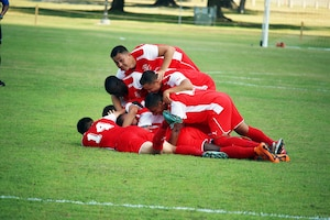 Fort Benning, Ga. - Marine Corps players celebrate after the game winning goal by Cpl Juan Medina (somewhere on the bottom) in the consolation match of the 2016 Armed Forces Men's Soccer Championship hosted at Fort Benning, Ga from 6-14 May 2016.  Marine Corps would go on to win the contest 3-2 to take third place.