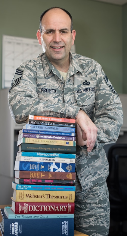 A book written by Air Force Reserve Chief Master Sgt. Matt Proietti, a longtime military public affairs professional, is included in the 2016 Air Force Chief of Staff Reading List. At All Costs is a biography of the late Chief Master Sgt. Richard L. Etchberger, who posthumously received the Medal of Honor in 2010, 42 years after his death during a battle at a secret U.S. radar camp in Laos.  (U.S. Air Force photo by Staff Sgt. Brenda Davis)