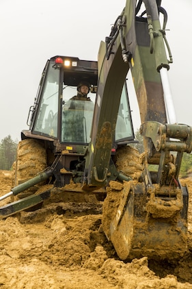 Lance Cpl. Austin Bradford, a heavy equipment operator with Marine Wing Support Squadron 171, engineer company, heavy equipment platoon, digs a fighting hole during exercise Thunder Horse 16.2 at the Japan Ground Self-Defense Force's Haramura Maneuver Area in Hiroshima, Japan, May 12, 2016. The week-long exercise focused on reinforcing skills that Marines learned throughout their military occupational specialty schooling and during Marine Combat Training in order to maintain situational readiness. Heavy equipment operators and combat engineers dug fighting holes for defensive positions, provided mechanical and road clearance with a bulldozer, conducted vehicle recovery, participated in security patrols and established a forward operating base. (U.S. Marine Corps photo by Lance Cpl. Aaron Henson/Released)
