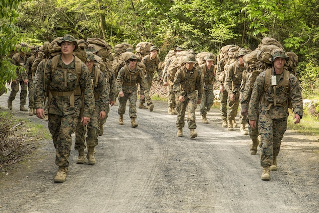 Marines with Marine Wing Support Squadron 171 participate in a hike during exercise Thunder Horse 16.2 at the Japan Ground Self-Defense Force's Haramura Maneuver Area in Hiroshima, Japan, May 12, 2016. The week-long exercise focused on reinforcing skills that Marines learned throughout their military occupational specialty schooling and during Marine Combat Training in order to maintain situational readiness. Motor transportation operators, bulk fuels specialists, and field radio operators trained in various areas including direct refueling, recovery and general engineering operations and established a tactical motor pool. (U.S. Marine Corps photo by Lance Cpl. Aaron Henson/Released)
