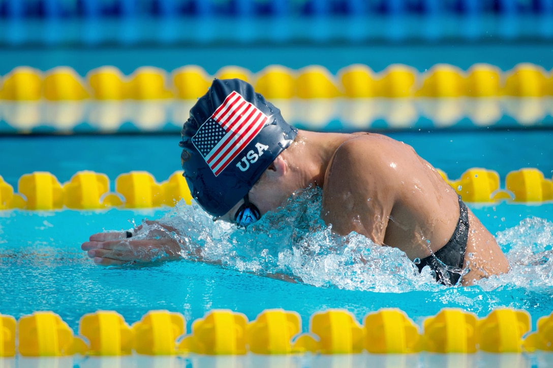 Army Staff Sgt. Elizabeth Marks swims for gold during the 2016 Invictus Games in Orlando, Fla., May 11, 2016. DoD photo by EJ Hersom