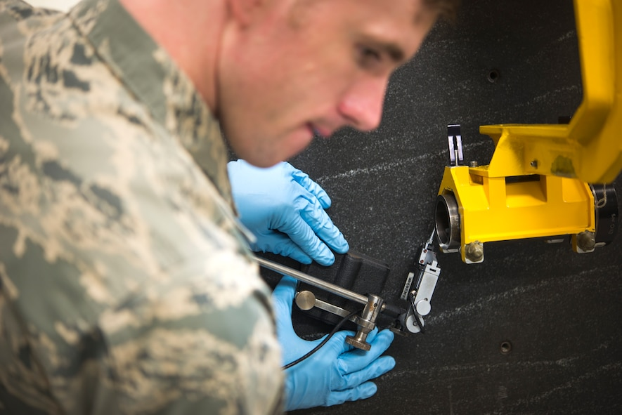 U.S. Air Force Staff Sgt. Benjamin Harvey, 18th Component Maintenance Squadron test, measurement and diagnostic equipment element supervisor, calibrates equipment used to align the guns of the F-15 Eagle May 10, 2016, at Kadena Air Base, Japan. The 18th CMS ensures the tools used by maintainers are calibrated so they can do their jobs and keep pilots safe. (U.S. Air Force photo by Senior Airman Omari Bernard)