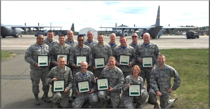 Members of the 103rd Maintenance Group proudly display their newly-earned Green Belts after graduating from a Six Sigma course taught by Master Sgt. Robert Walsh (lower right).   Walsh is a Black Belt assigned as a personnelist with the 103rd Force Support Squadron.   Six Sigma is a set of techniques and tools for process improvement used in many industrial sectors, and within the U.S. Air Force.  Green Belts are Airmen who take up Six Sigma implementation as an additional duty operating under the guidance of Black Belts.  Black Belts are seasoned Six Sigma professionals who can apply Six Sigma methodology to specific projects.  (Photo Courtesy of Capt. Cheryl Mead, 103rd Maintenance Group.)