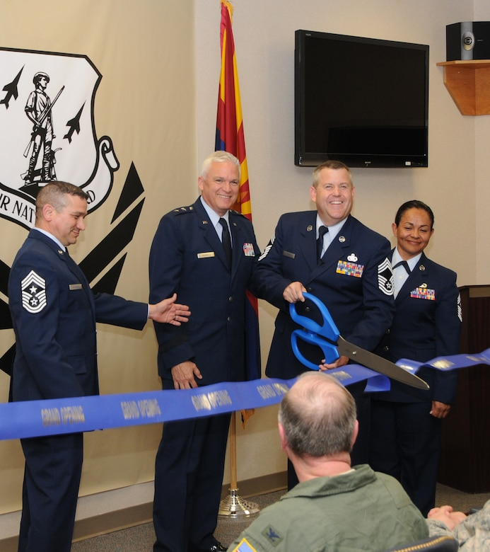 13. Maj. Gen. Edward Maxwell, commander of the Arizona Air National Guard, Chief Master Sgt. Daniel Gutierrez, state command chief master sergeant, Chief Master Sgt. Martha Garcia, 161st Air Refueling Wing command chief, and Chief Master Sgt. Bert Reid, 161st Logistics Readiness Squadron chief enlisted manager, commemorate the wing's new Center for Enlisted Leadership and Learning at a ribbon cutting ceremony at the Phoenix Air National Guard base, May 15. The CELL will offer all wing enlisted Airmen the opportunity to participate in professional development and leadership training; aligning the wing with the strategic roadmap set forth by the Secretary of the Air Force.
