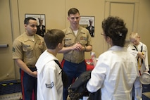 Sergeant Francisco Martinez, left, and Capt. Wesley Jagoe speak with a student and his mother about engineering opportunities in the Marine Corps during the Naval STEM Exposition in Fort Washington, Md. May 15, 2016. The Marine Corps recognizes the event as a valuable opportunity to foster positive relationships with students, share the Marine story, and reinforce the idea of the armed services as a viable career option. Martinez is apart of reserve support with Marine Corps Recruiting Command. Jagoe is a reserve support officer for Recruiting Station Frederick.