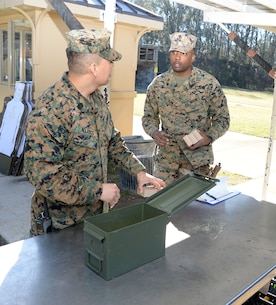 Master Sgt. Roberto Nolasco (left), operations and training chief, Military Operations and Training Branch, and Sgt. Tavarez Hayman, ammunition technician, Logistics Support Division, Marine Corps Logistics Base Albany, prepare to distribute ammo to Marines, Sailors and Marine Corps police officers taking the Combat Pistol Program course of fire qualification at MCLB Albany. The CPP training is one of several scheduled and conducted on the installation's pistol range to facilitate annual qualification requirements for service members and law enforcement personnel.