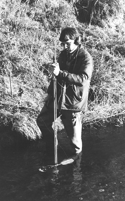 Mark Nelson takes stream measurements in Little Salt Creek (Lincoln, Neb) using a standard AA stream gauge meter while working for the State of Nebraska in 1980.