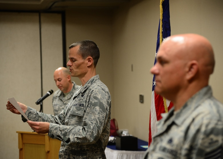 Col. Ben Maitre, 27th Special Operations Wing commander, officially graduates 33 Air Commandos by reading the Community College of the Air Force graduation decree May 13, 2016, at Cannon Air Force Base, N.M. Despite the challenges of working long hours, familial obligations and the high-intensity tempo of Air Force Special Operations Command, 129 Air Commandos went above and beyond this past graduation cycle to achieve this education milestone. (U.S. Air Force photo/Senior Airman Chip Slack)