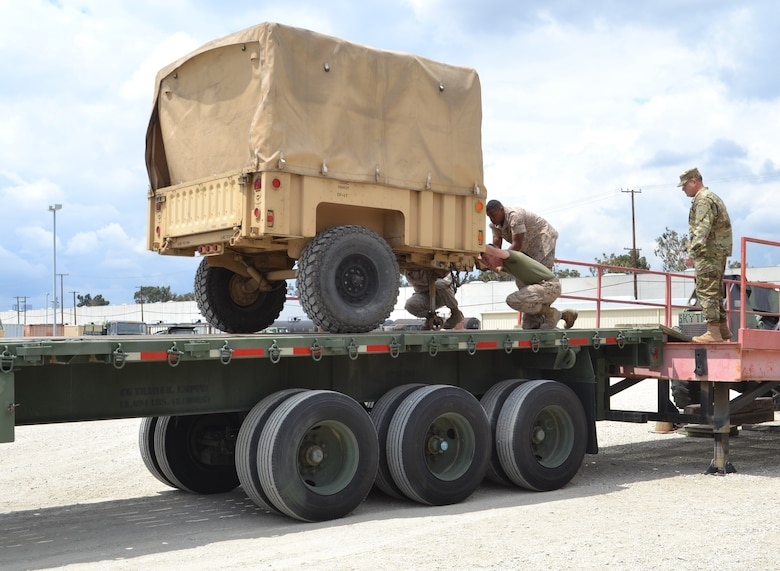 Soldiers from the 729th Transportation Company, Fresno, Calif., and Marines from the 3rd Air Naval Gunfire Liaison Company worked together, loading a M-872 Series 40-foot, 34-ton flatbed semitrailer, with cargo and the equipment, which will be used at Operation Maple Resolve and is being conducted at Canadian Forces Base Wainwright, east of Edmonton, Canada. Operation Maple Resolve is the Canadian Forces largest training exercise of the year.
