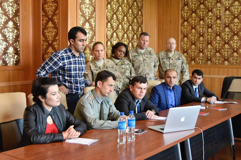 U.S. Army Central Public Affairs Soldiers watch an example of how not to deal with the media with Tajikistan communications officers during a Public Affairs exchange April 22, in Dushanbe, Tajikistan.