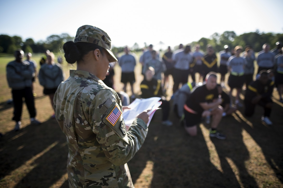Sgt. 1st Class Tiffany Apholz, U.S. Army Reserve budget analyst for the 200th Military Police Command, gives the Army Physical Fitness Test's initial briefing to a group of Soldiers about to take the test, May 14, during battle assembly at Fort Meade, Maryland. (U.S. Army photo by Master Sgt. Michel Sauret)