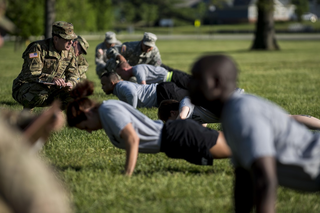 U.S. Army Reserve Soldiers from the 200th Military Police Command's headquarters company conduct the push-up event as part of the Army Physical Fitness Test, May 14, during battle assembly at Fort Meade, Maryland. (U.S. Army photo by Master Sgt. Michel Sauret)