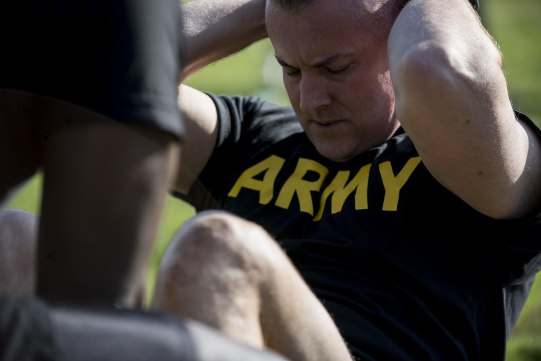 Maj. John Mullaney, U.S. Army Reserve commander of the 200th Military Police Command's headquarters company, conducts sit-ups during the Army Physical Fitness Test, May 14, during battle assembly at Fort Meade, Maryland. (U.S. Army photo by Master Sgt. Michel Sauret)