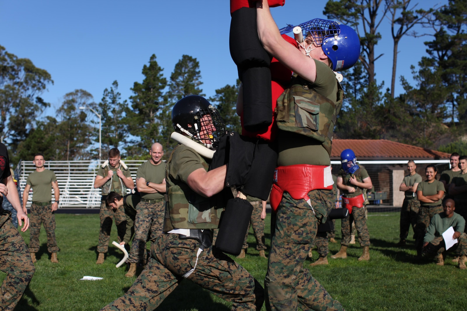 Marines from the Marine Corps Detachment test their martial skills during a pugil stick bout.